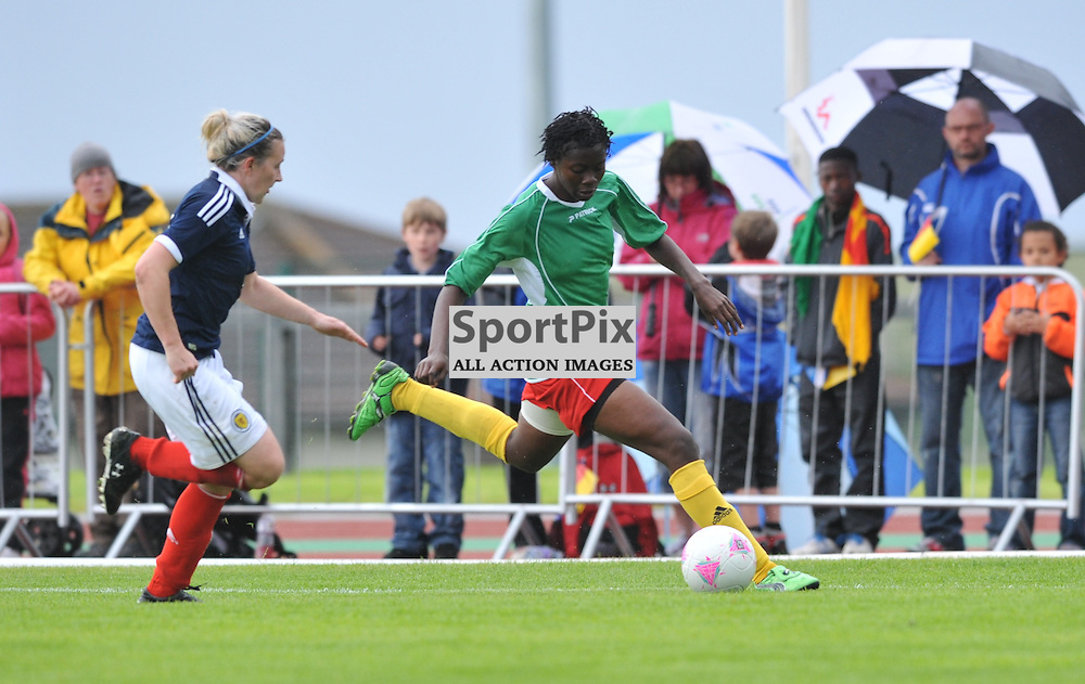 Frankie Brown tries to catch up with her opponent during the Cameroon vs Scotland in pre Olympic warm up match. 15th July 2012.