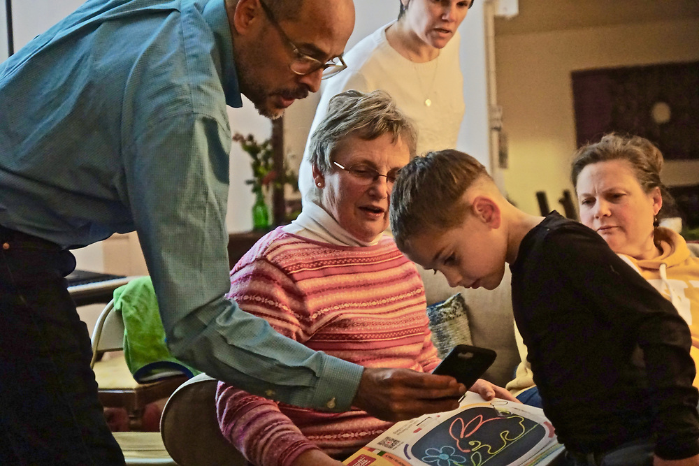 Family gathering at holiday includes grandmother, son-in-law. grandchild and mother