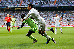 Cristiano Ronaldo of Real Madrid is tackled by Bacary Sagna of Manchester City - Mandatory byline: Rogan Thomson/JMP - 04/05/2016 - FOOTBALL - Santiago Bernabeu Stadium - Madrid, Spain - Real Madrid v Manchester City - UEFA Champions League Semi Finals: Second Leg.
