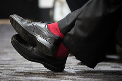 © Licensed to London News Pictures . 30/09/2015 . Brighton , UK . Labour Party Leader JEREMY CORBYN wearing red socks and a suit as he gives interviews at the conference venue this morning ( Wednesday 30th September 2015 ) . The 2015 Labour Party Conference . Photo credit : Joel Goodman/LNP