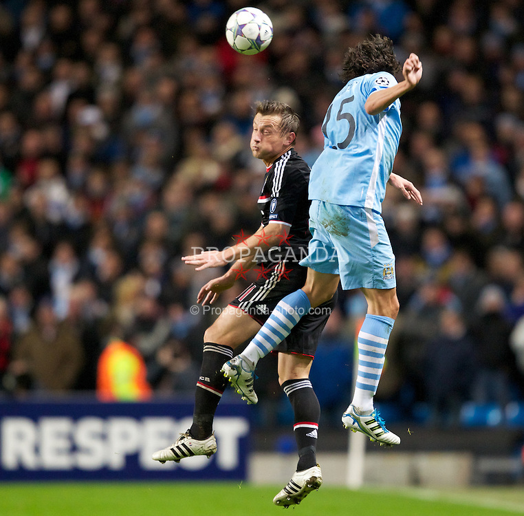 MANCHESTER, ENGLAND - Wednesday, December 7, 2011: Manchester City's Stefan Savic in action against FC Bayern Munchen's Ivica Olic during the UEFA Champions League Group A match at the City of Manchester Stadium. (Pic by Vegard Grott/Propaganda)