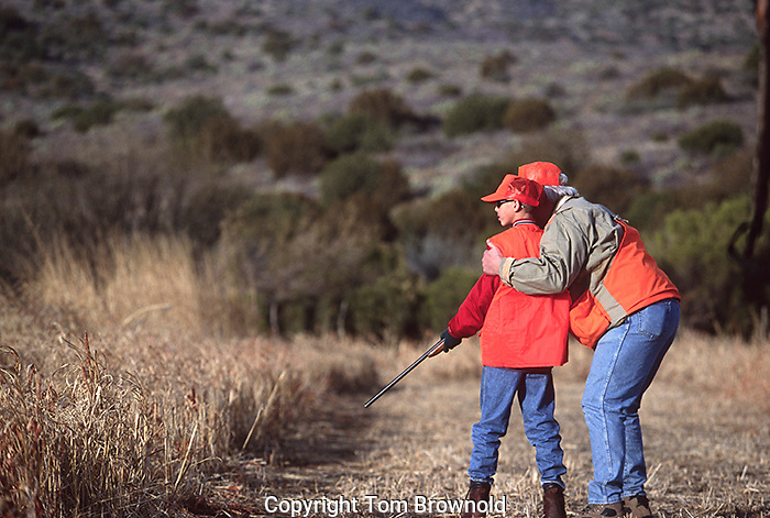 Hunting lesson. A Father teaching his son when to hold fire and when to shoot