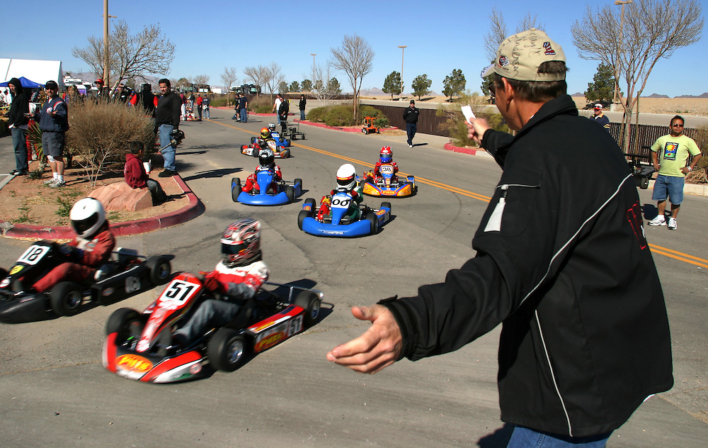 A race official waves drivers on to the track for an International Karting Federation race in Primm, Nevada on Saturday March 3, 2007..