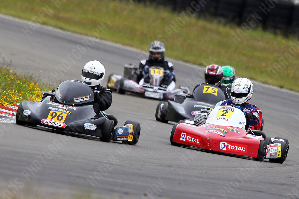 Teddy Bassick, 96, Karl Cameron, 2, Daniel Sayles, 75, and David Lundt, 14, race in the Rotax Light class during the 2012 Superkart National Champs and Grand Prix at Manfeild in Feilding, New Zealand on Saturday, 7 January 2011. Credit: Hagen Hopkins.