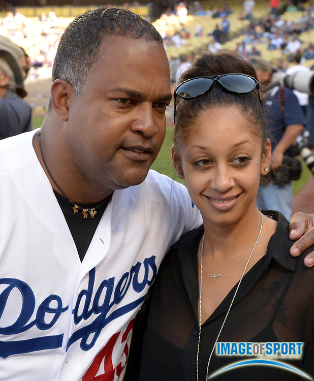 Apr 6, 2014; Los Angeles, CA, USA; Los Angeles Dodgers former player Raul Mondesi (43) poses with Desiree LeSassier before the game against the San Francisco Giants at Dodger Stadium.