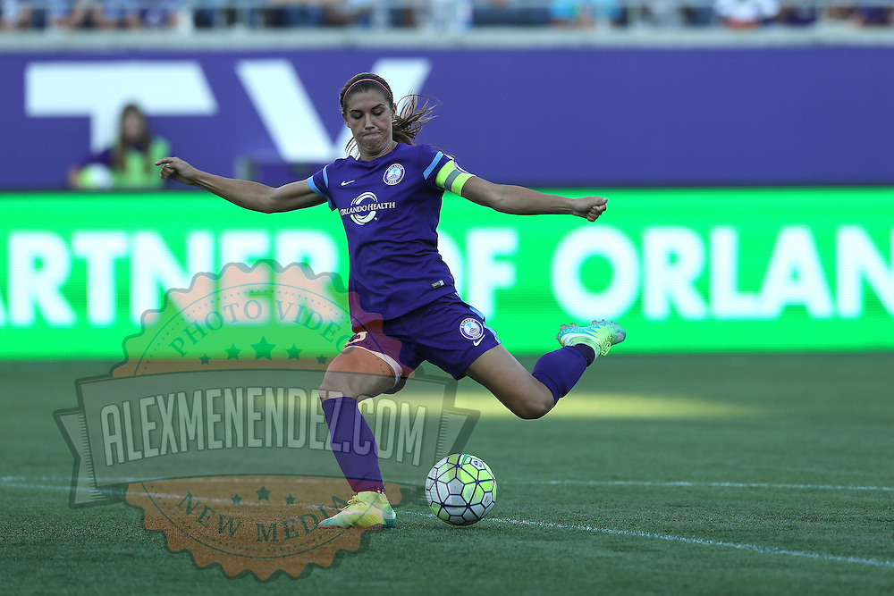 Orlando Pride forward Alex Morgan (13) kicks the ball during a NWSL soccer match at Camping World Stadium on May 8, 2016 in Orlando, Florida. (Alex Menendez via AP)