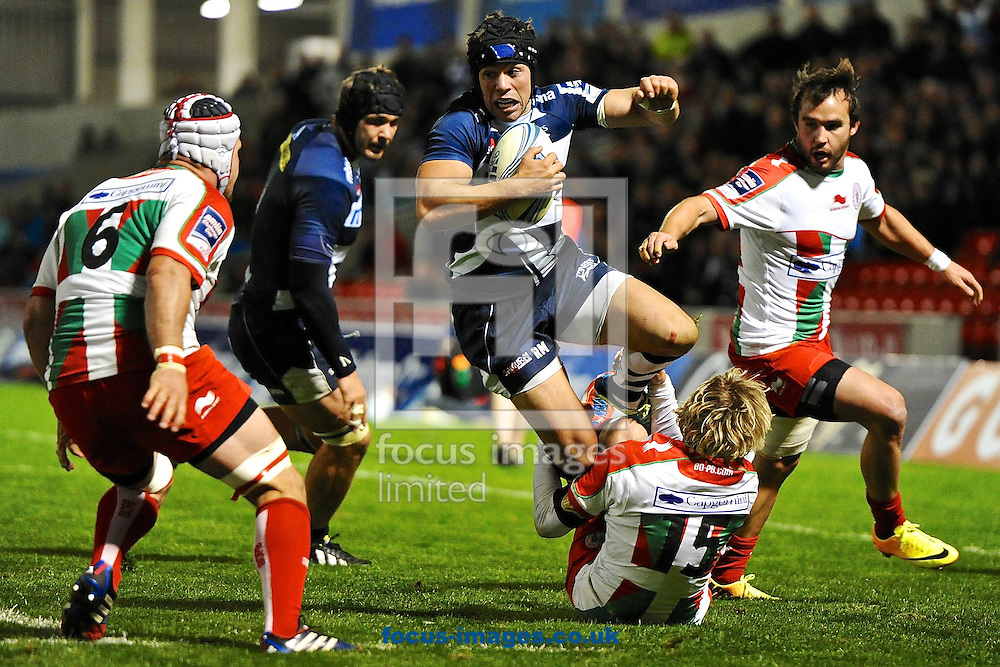 Picture by Ian Wadkins/Focus Images Ltd +44 7877 568959<br /> 10/10/2013<br /> Kirill Kulemin of Sale Sharks is tackled by Jo Pietersen of Biarritz Olympique during the Amlin Challenge Cup match at AJ Bell Stadium, Eccles.