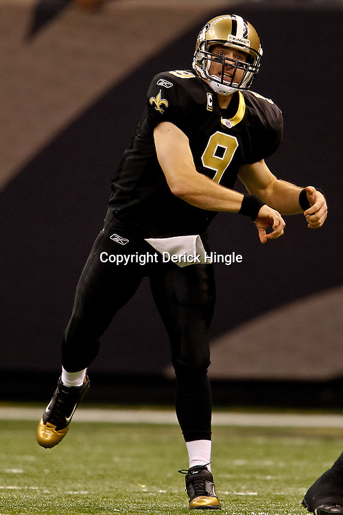 November 21, 2010; New Orleans, LA, USA; New Orleans Saints quarterback Drew Brees (9) during a game against the Seattle Seahawks at the Louisiana Superdome. Mandatory Credit: Derick E. Hingle