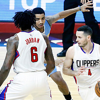 20 December 2016: LA Clippers guard J.J. Redick (4) drives past Denver Nuggets guard Jamal Murray (27) on a screen set by LA Clippers center DeAndre Jordan (6) during the LA Clippers 119-102 victory over the Denver Nuggets, at the Staples Center, Los Angeles, California, USA.