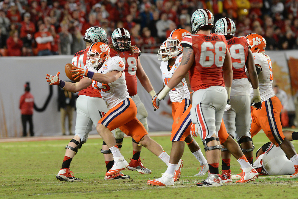 January 3, 2014: Spencer Shuey #33 of Clemson celebrates after intercepting a pass during the NCAA football game between the Clemson Tigers and the Ohio State Buckeyes at the 2014 Orange Bowl in Miami Gardens, Florida. The Tigers defeated the Buckeyes 40-35.