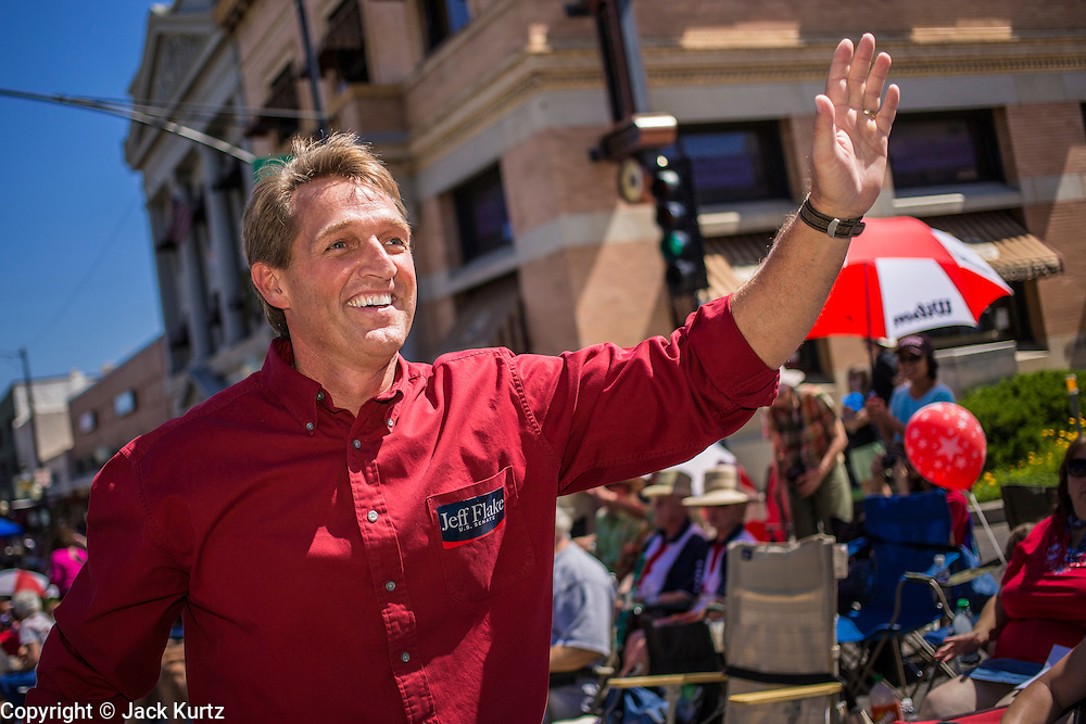 30 JUNE 2012 - PRESCOTT, AZ:  Republican Congressman JEFF FLAKE, a candidate for the US Senate, works the crowd at the Prescott Frontier Days Rodeo Parade. Prescott is solidly Republican and the parade is popular with Republican political candidates. Flake is in a primary battle with businessman Wil Cardon, who did not attend the parade. The parade is marking its 125th year. It is one of the largest 4th of July Parades in Arizona. Prescott, about 100 miles north of Phoenix, was the first territorial capital of Arizona.    PHOTO BY JACK KURTZ