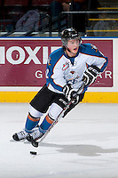 KELOWNA, CANADA - DECEMBER 7: Luke Philp #12 of the Kootenay Ice skates with the puck against the Kelowna Rockets on December 7, 2013 at Prospera Place in Kelowna, British Columbia, Canada.   (Photo by Marissa Baecker/Shoot the Breeze)  ***  Local Caption  ***