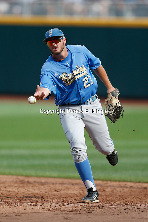 Jun 24, 2013; Omaha, NE, USA; UCLA Bruins first baseman Pat Gallagher (27) tosses the baseball during infield drills before game 1 of the College World Series finals against the Mississippi State Bulldogs at TD Ameritrade Park. Mandatory Credit: Derick E. Hingle-USA TODAY Sports