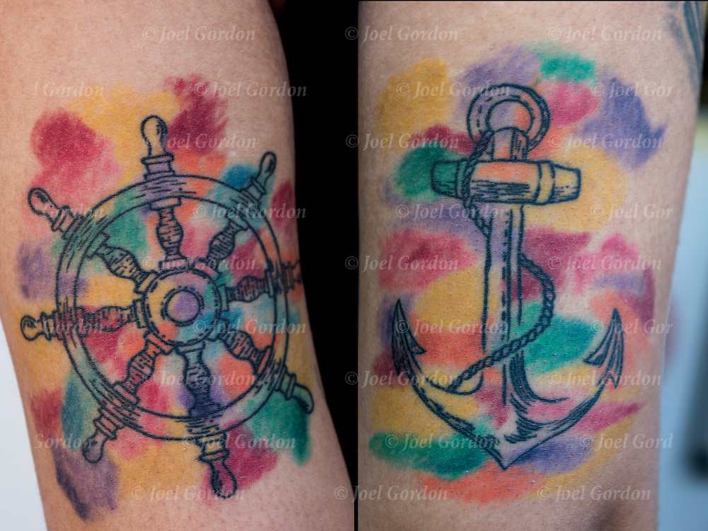 Tattoo of ship's wheel and anchor tattoos on her arms.<br /> <br /> Tattoos are no longer just a male thing, young women are just as likely to get a tattoo as males. <br /> <br /> Body art or tattoos has entered the mainstream it is no longer considered a weird kind of subculture.<br /> <br /> &quot;According to a 2006 Pew survey, 40% of Americans between the ages of 26 and 40 have been tattooed&quot;.