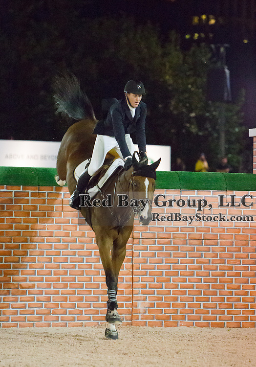 Mclain Ward riding ZZ-Top VH Schaarbroek Z competes in the Puissance at the Rolex Central Park Horse Show, where Land Rover was the official vehicle sponsor on September 22, 2016 in New York City.