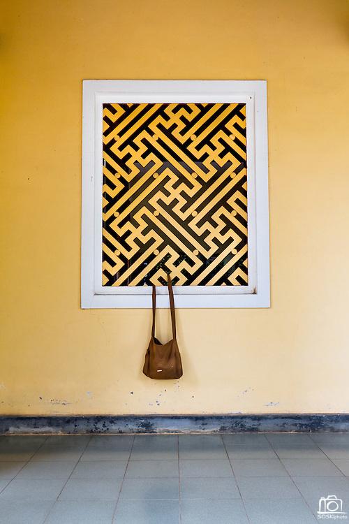 A satchel hangs from the window of the Chua Dieu Vien Pagoda in Hue, Vietnam.  Photo by Stan Olszewski/SOSKIphoto