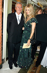 Model LAURA BAILEY and MICHAEL WHITE at the Chain of Hope 10th Anniversary Ball held at The Dorchester, Park Lane, London on 1st November 2005.<br />