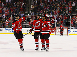 Jan 21, 2008; Newark, NJ, USA; New Jersey Devils defenseman Johnny Oduya (29), New Jersey Devils defenseman Paul Martin (7) and New Jersey Devils center Brian Rolston (12) celebrate Oduya's goal during the second period at the Prudential Center.