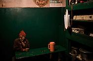 A man sits in an Indian dhaba, Kargil