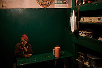 A man sits in an Indian dhaba, Kargil