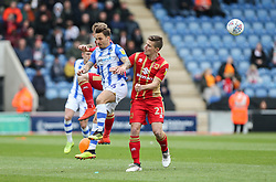 Sam Saunders of Colchester United beats David Wheeler of Milton Keynes Dons to the ball - Mandatory by-line: Arron Gent/JMP - 27/04/2019 - FOOTBALL - JobServe Community Stadium - Colchester, England - Colchester United v Milton Keynes Dons - Sky Bet League Two