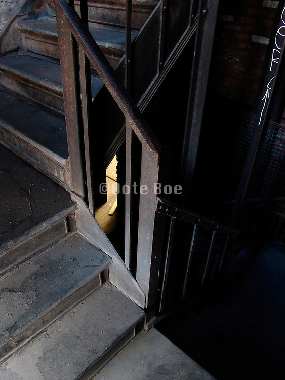 old stairwell with open door in the background