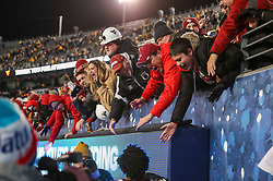 Nov 23, 2018; Morgantown, WV, USA; Oklahoma Sooners fans celebrate after beating the West Virginia Mountaineers at Mountaineer Field at Milan Puskar Stadium. Mandatory Credit: Ben Queen-USA TODAY Sports