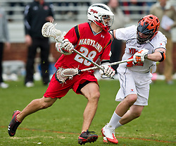 Maryland Terrapins Midfield Jeff Reynolds (28) is defended by Virginia Cavaliers M Max Pomper (42).  The #9 ranked Maryland Terrapins fell to the #1 ranked Virginia Cavaliers 10 in 7 overtimes in Men's NCAA Lacrosse at Klockner Stadium on the Grounds of the University of Virginia in Charlottesville, VA on March 28, 2009.