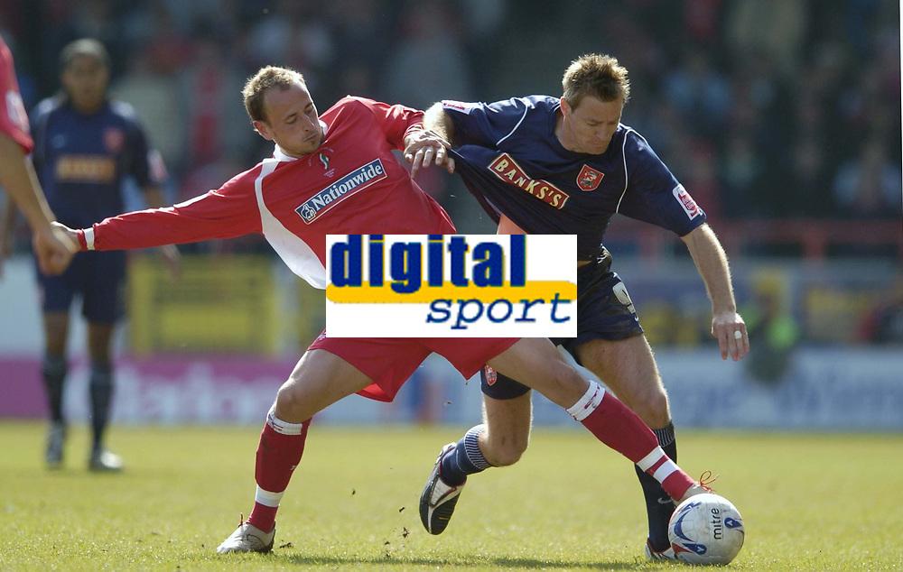 Photo: Jonathan Butler.<br /> Swindon Town v Walsall. Coca Cola League 2. 05/05/2007.<br /> Blair Sturrock of Swindon holds back Martin Butler of Walsall.