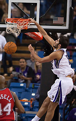 November 27, 2009; Sacramento, CA, USA;  Sacramento Kings forward Omri Casspi (18) dunks against the New Jersey Nets during the second quarter at the ARCO Arena.  Sacramento defeated New Jersey 109-96.