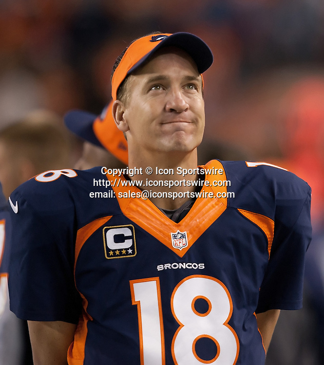 Oct. 19, 2014 - Denver, Colorado, U.S - Broncos QB PAYTON MANNING looks up to the jumbo tron to see his record TD pass being replayed during the 2nd. quarter at Sports Authority Field at Mile High Sunday afternoon. The Broncos beat the 49ers 42-17