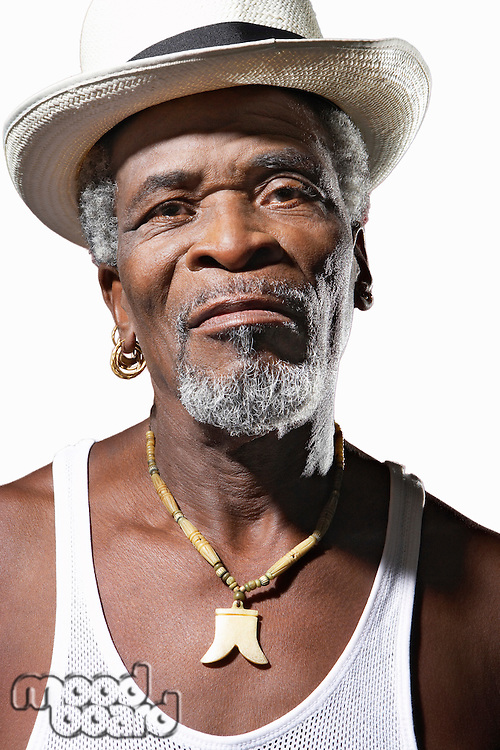 Close-up African American senior man wearing hat over white background