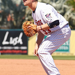 March 13, 2011; Fort Myers, FL, USA; Minnesota Twins first baseman Justin Morneau (33) during a spring training exhibition game against the Philadelphia Phillies at Hammond Stadium.   Mandatory Credit: Derick E. Hingle