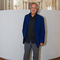 "VENICE, ITALY - MAY 31:  Artist Anish Kapoor stands in front of his installation ""Ascension"" during the press opening at Basilica di San Giorgio on May 31, 2011 in Venice, Italy. ""Ascension"" is an installation that cosnist of a column of white smoke rising from a circular base placed at the intersection between the transet and the nave of Basilica of San Giorgio Maggiore"