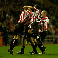 Photo. Glyn Thomas. <br /> Sunderland v Nottingham Forest. <br /> Coca Cola Championship. 14/09/2004.<br /> Sunderland's Julio Arca (second from L) is mobbed by teammates after scoring his side's first goal.