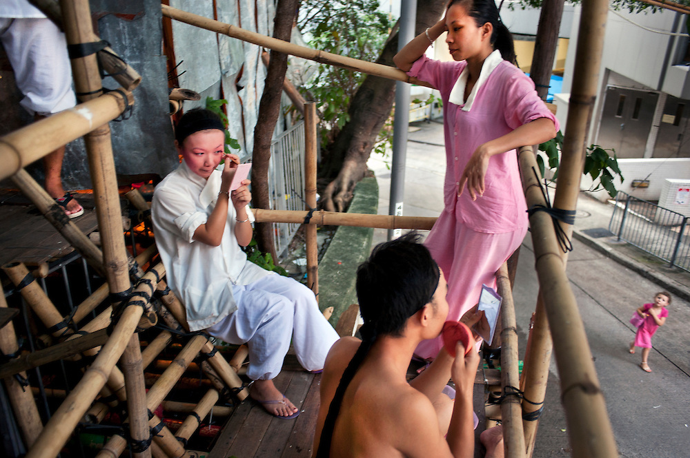 Chaozhou style opera in Shek Tong Tsui<br /> Actors putting make up on outside a temporary bamboo theatre