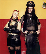 Young goth man and woman standing together and posing.