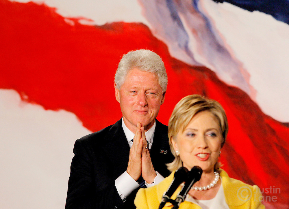 Former US President Bill Clinton stands behinds his wife Sen. Hillary Clinton,  D-NY, as she addresses the crowd at a New York State Democratic Party election night event after she was reelected in New York on Tuesday 07 November 2006.
