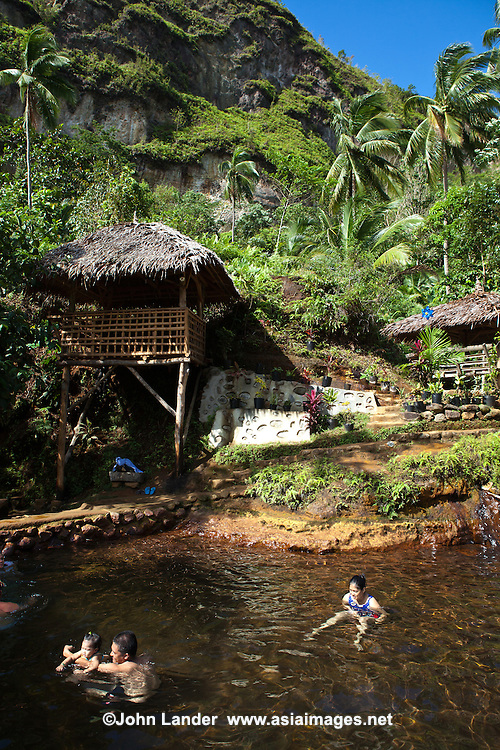 Red Rock Hot Spring at Pulangtubig, Valencia, Negros Oriental is a great way to relax in the cool upland temperatures of Valencia. The natural source of spring water averaging from 38 degrees Celsius. Soakers who come here regularly claim that they have been relieved of the signs and symptoms of such health problems as Asthma, Arthritis, Allergic Rhinitis, Fatigue, Insomnia, Malaise, Sinusitis and among others.  Bathers can be assured of water's cleanliness and sanitation while bathing. as it is constantly circulating and refreshed and is drained every night.