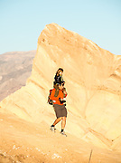 Jonas Bergdahl of Sweden carries his 5-year-old daughter Elvina on a sunrise hike to Zabriskie Point in Death Valley National Park, Calif., on Oct. 26, 2012.