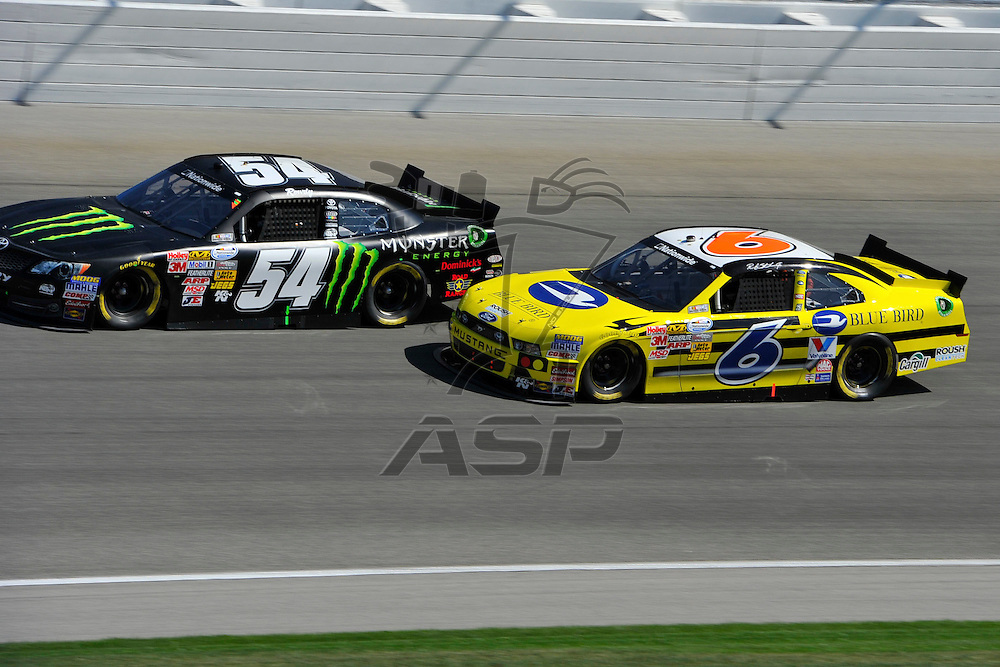 Joliet,Il - Sep 15, 2012: Kyle Busch (54) and Ricky Stenhouse, Jr. (6) race side by side during race action for the Dollar General 300 at Chicagoland Speedway in Joliet, Il.