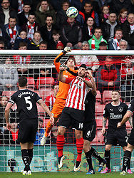 Burnley's Thomas Heaton punches under pressure from Southampton's Graziano Pelle - Photo mandatory by-line: Robbie Stephenson/JMP - Mobile: 07966 386802 - 21/03/2015 - SPORT - Football - Southampton - ST Marys Stadium - Southampton v Burnley - Barclays Premier League