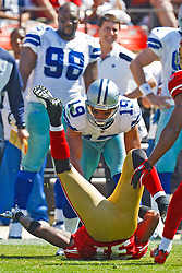 September 18, 2011; San Francisco, CA, USA; Dallas Cowboys wide receiver Miles Austin (19) blocks San Francisco 49ers strong safety Donte Whitner (31) into the ground during the first quarter at Candlestick Park.  Dallas defeated San Francisco 27-24 in overtime.