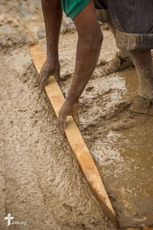 Workers build the Lenkishon ELCK (Evangelical Lutheran Church in Kenya) Project 24 site on Saturday, June 25, 2016, in Lenkishon, Kenya.  LCMS Communications/Erik M. Lunsford