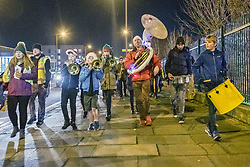 Portobello, Edinburgh's seaside suburb, was buzzing last night with a musical street procession as part of a locally organised community late night shopping event. Santa was there too to turn on the Christmas lights.<br /> © Jon Davey/ EEm