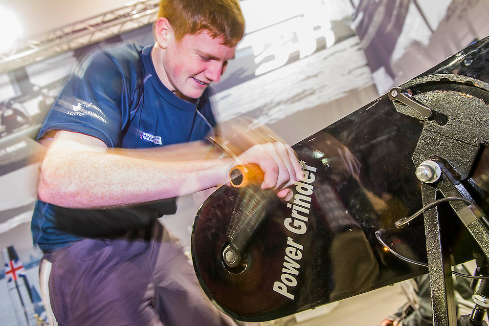 A winching challenge causes pain on the BAR  - Ben Ainslie Racing - Stand.  BAR has beenset up to challenge for the Americas Cup. The CWM FX London Boat Show, taking place 09-18 January 2015 at the ExCel Centre, Docklands, London. 09 Jan 2015.