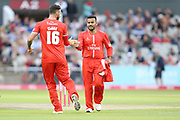 Lancashires Jordan Clark congratulates Lancashires Zahir Khan for his two wickets during the Vitality T20 Blast North Group match between Lancashire Lightning and Durham Jets at the Emirates, Old Trafford, Manchester, United Kingdom on 7 August 2018.