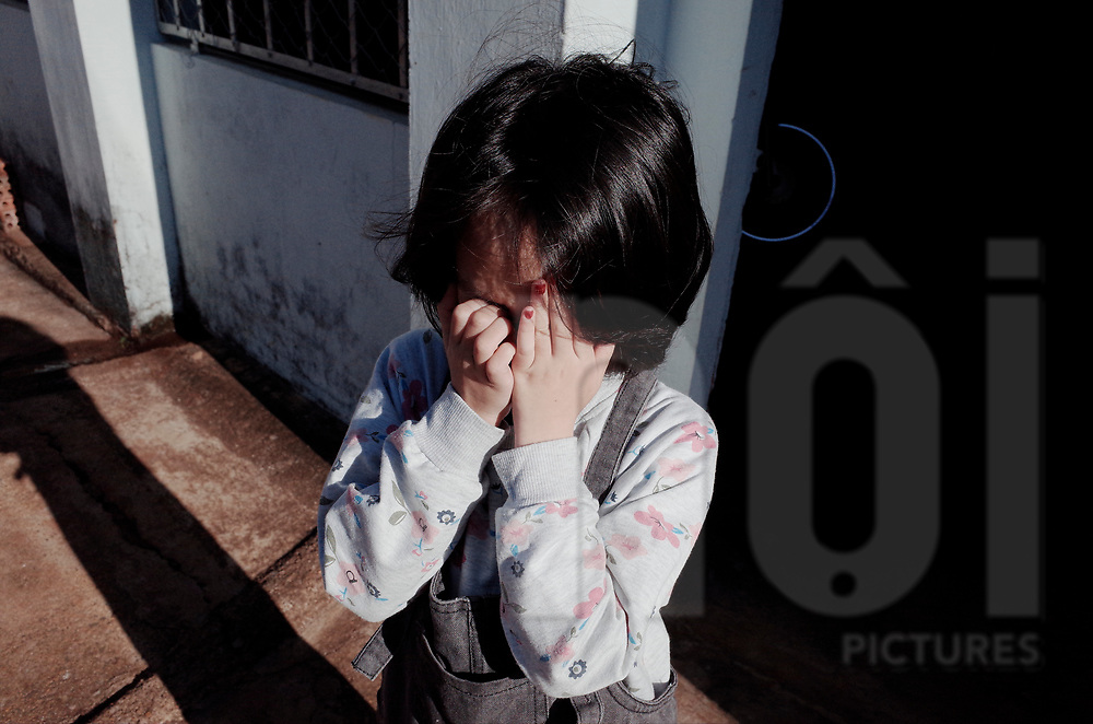 Portrait of a cranky young Vietnamese kid, Vietnam, Southeast Asia