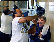"""Lightnin"" Ray Lampkin gets some encouragement on the speedbag from is former manager Mike Morton while playing around at the Knott Street Boxing Club. Ray came to spend some time working in the ring with his step son Marcus Pernell, a promising light heavyweight boxer."