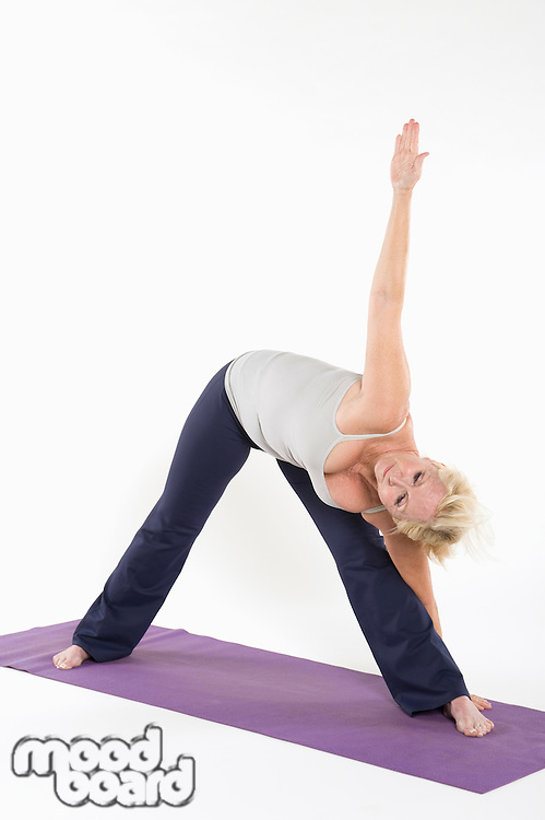 Full length of a woman bending while exercising
